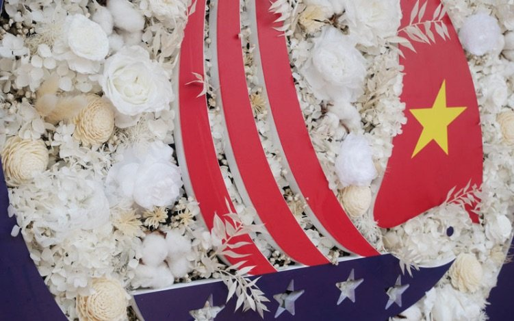 US-Consulate-Tet-Booth-Flower-Logo